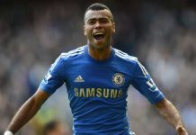 Ashley Cole celebrates scoring against Stoke City