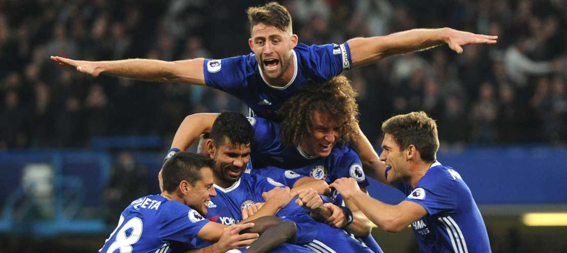 Cahill celebrates scoring against Manchester United
