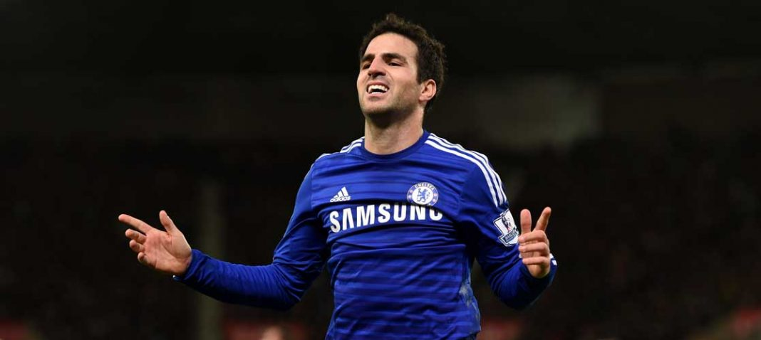 Fabregas celebrates at Stoke City