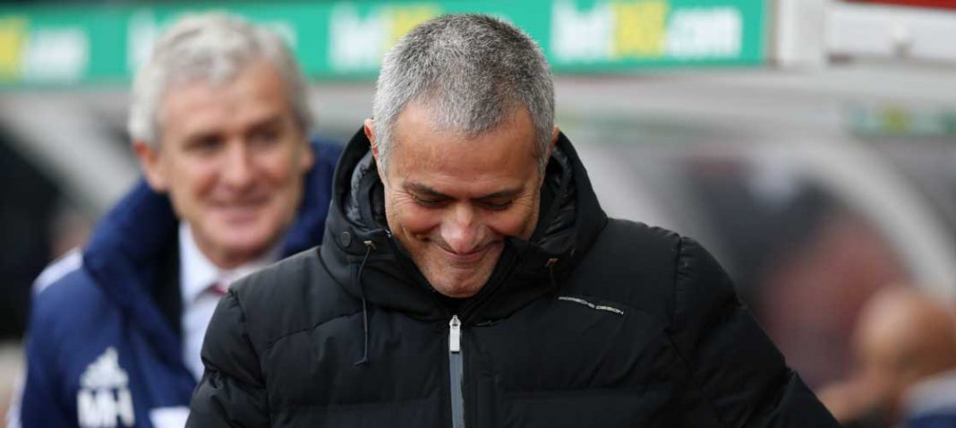 Jose Mourinho shares a pre-match joke with Mark Hughes