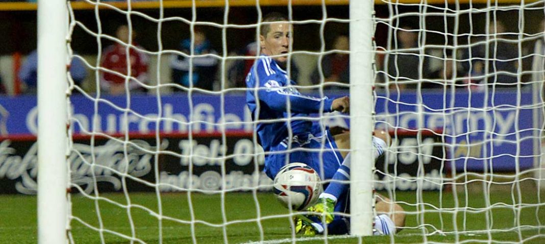 Fernando Torres scores against Swindon Town
